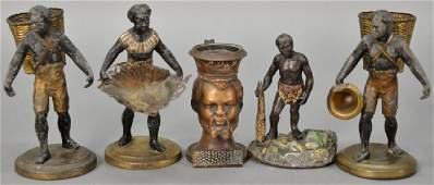 Five Blackamoor figures including pair of white metal