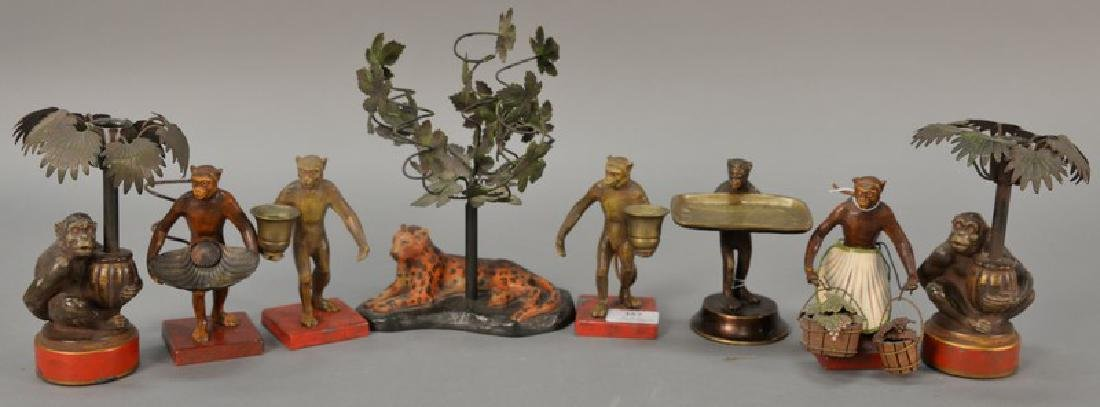 Group of eight figural candle holders including pair of