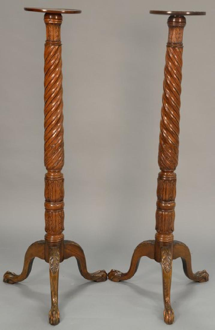 Pair of tall mahogany fern stands on turned shafts, set
