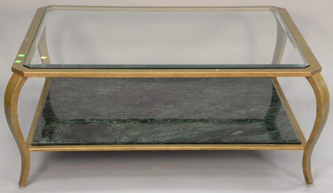 Glass top coffee table with metal frame and marble