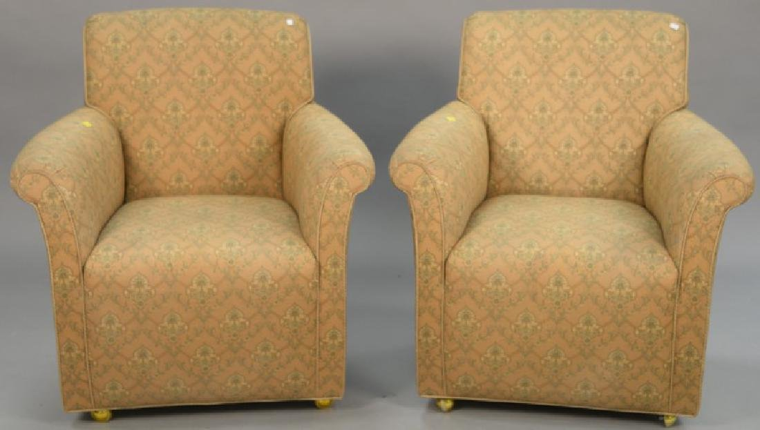 Pair of upholstered Swaim easy chairs.