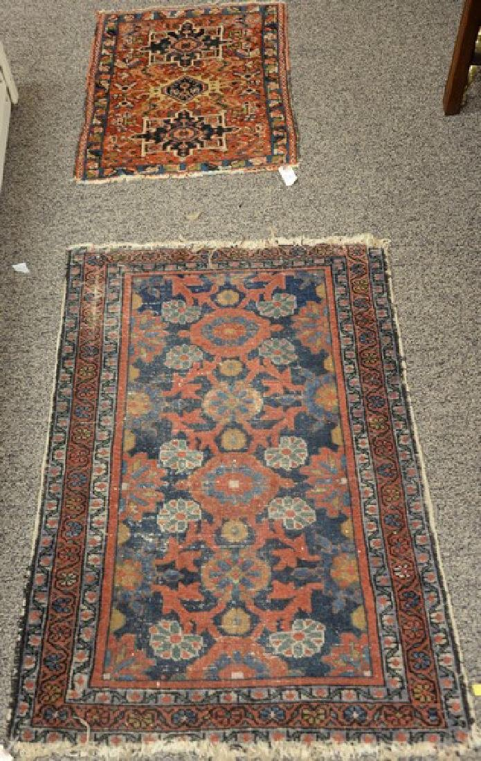 "Two Oriental throw rugs. 2'6"" x 3'9"" and 1' x 2'6"""