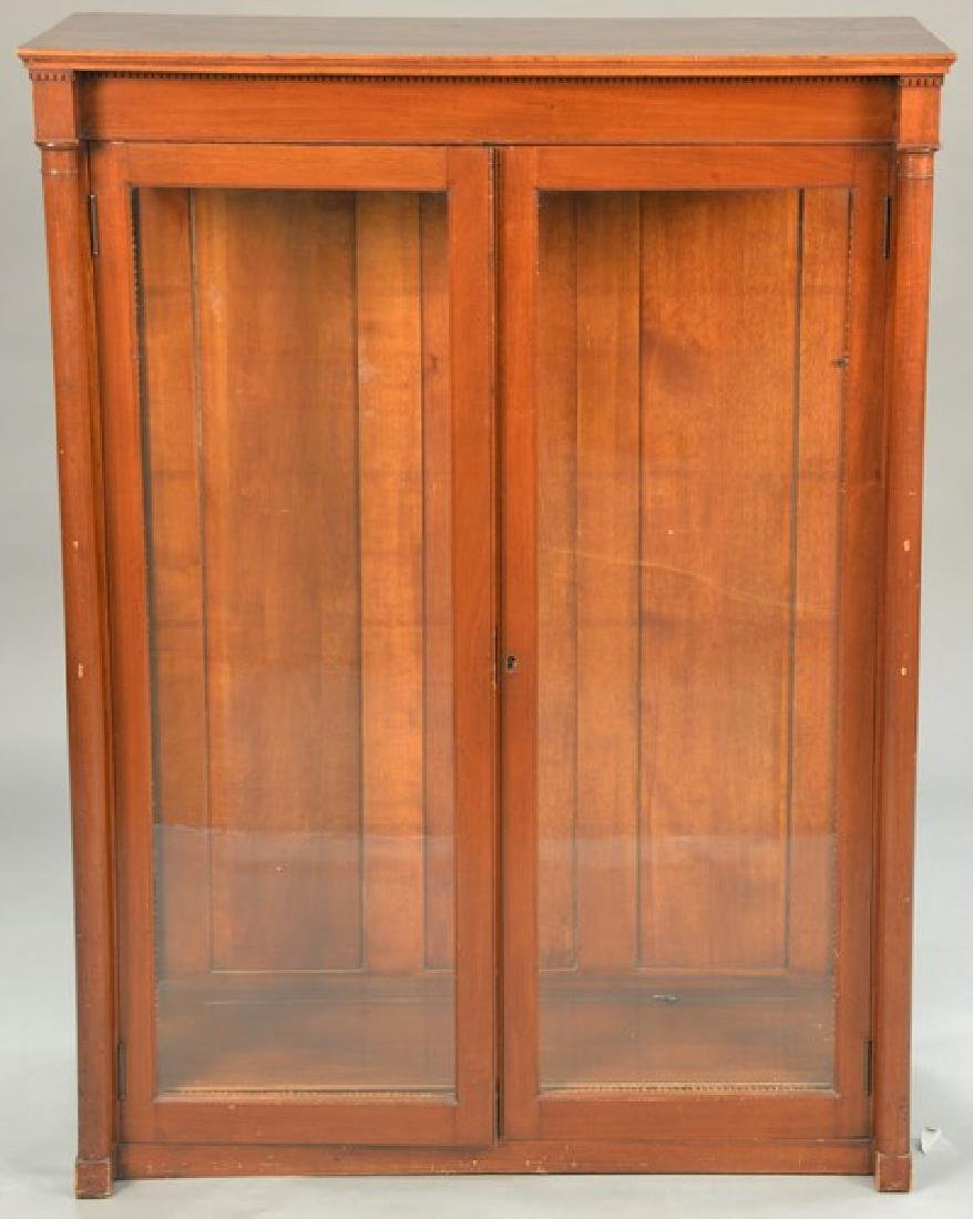 Mahogany two door bookcase, ht. 51 1/2in., wd. 38
