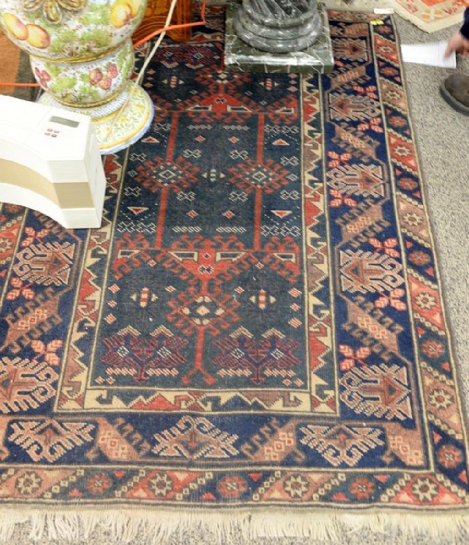 Oriental throw rug, 4' x 6'.