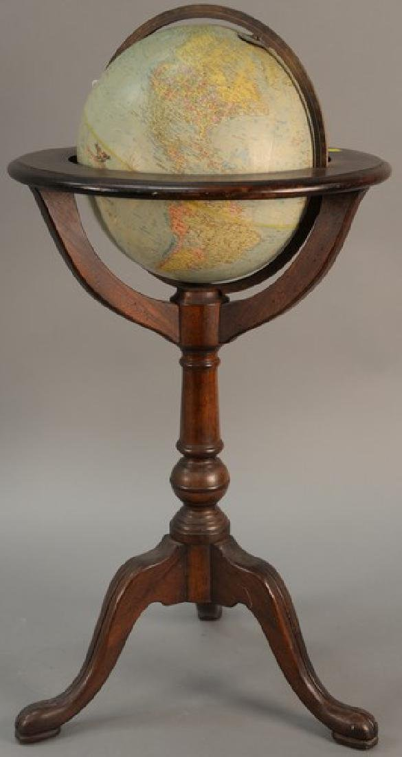 Globe on wood stand. ht. 35in., total dia. 17in.
