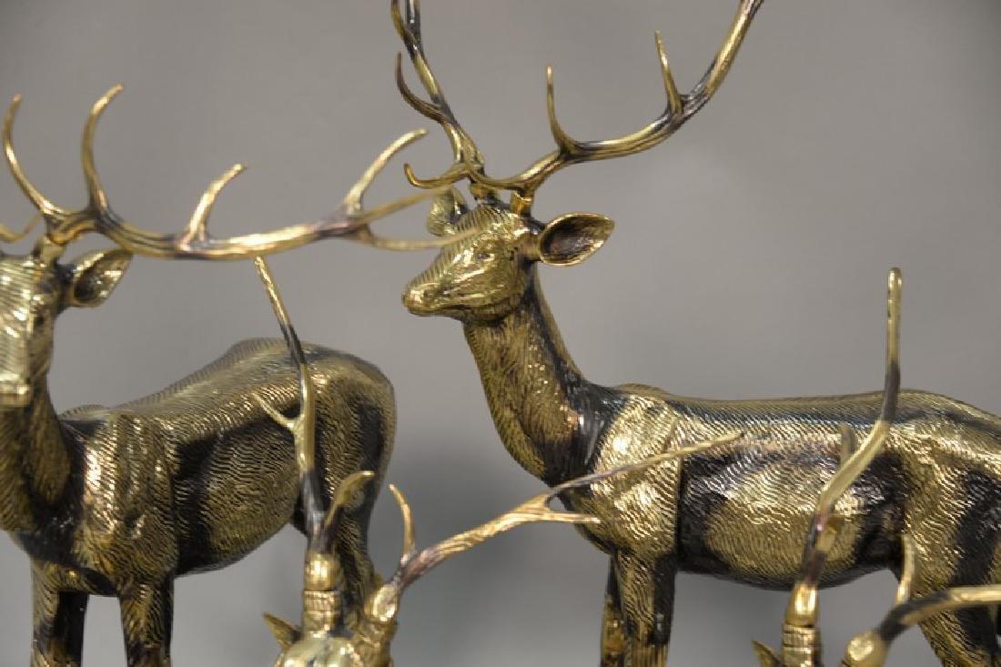 Eight piece Continental brass deer grouping. largest: - 3