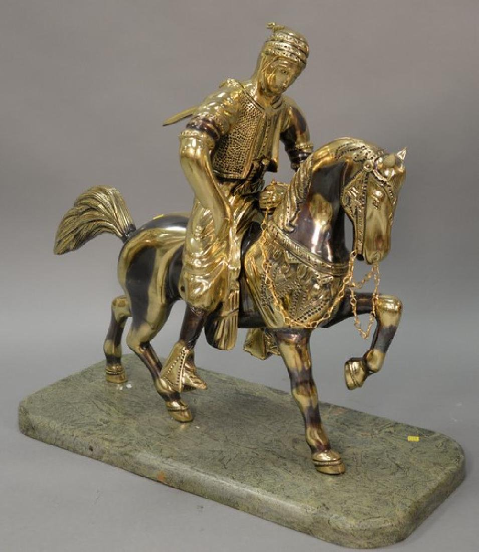Large contemporary brass horse with rider on marble