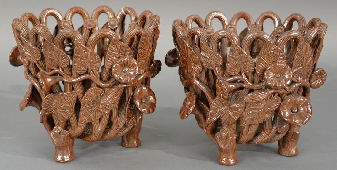 Pair of brown stoneware openwork jardiniers mounted
