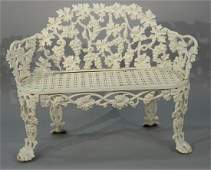 Iron Victorian bench having grape and vine motif and