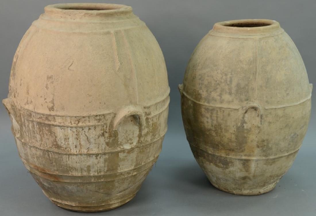 Two large earthenware urns, each with built in handles