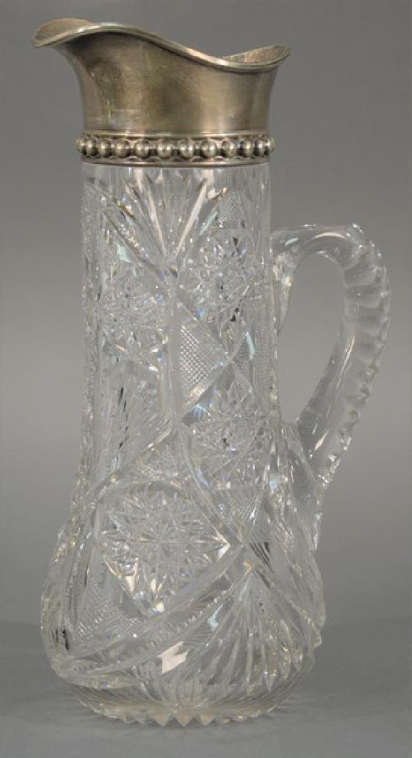 Libbey cut glass pitcher with sterling silver top.