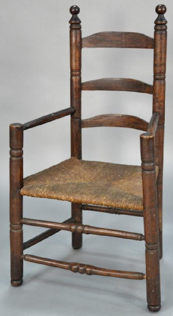 Primitive ladder back great chair having turned
