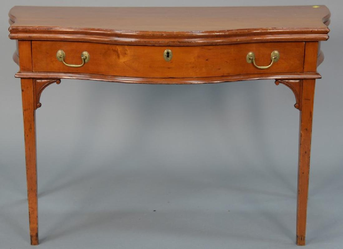 Federal cherry game table with bowed front top over
