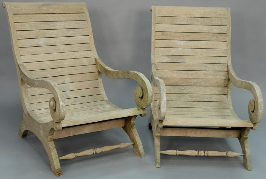 Pair of teak plantation style armchairs.   height to