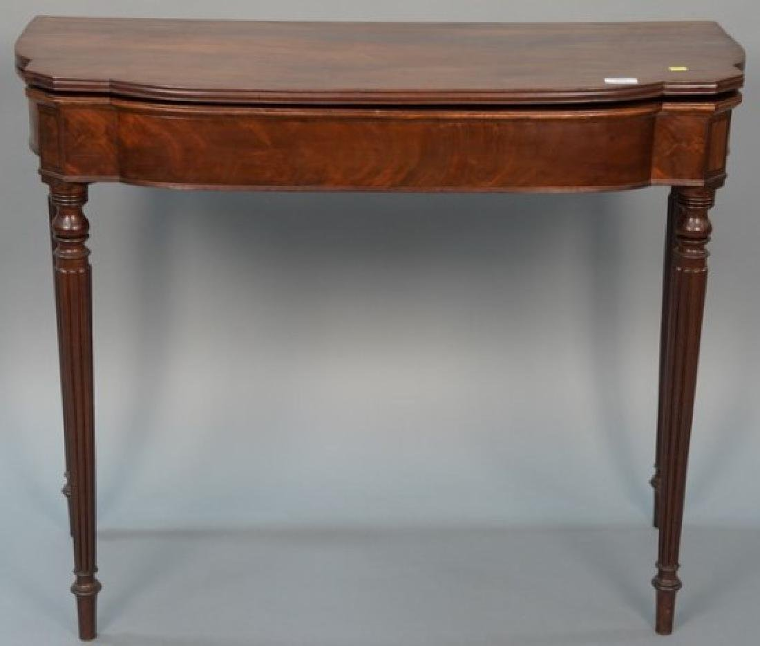 Sheraton mahogany games table with shaped top over