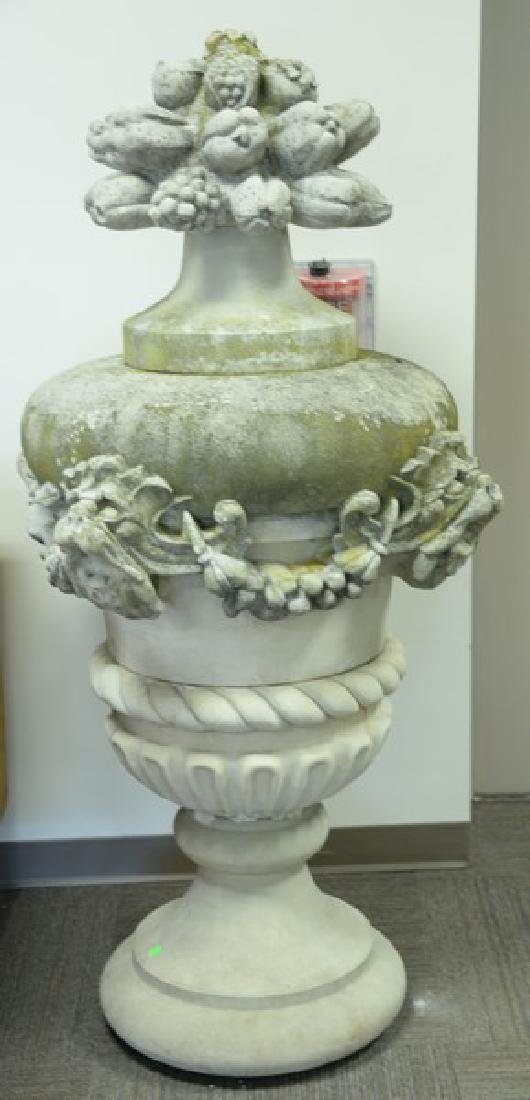 Pair of large cement covered urns in five parts.
