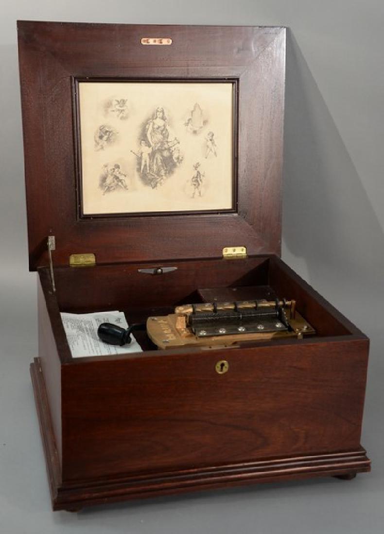 Regina music box, double comb with twenty-two discs, in