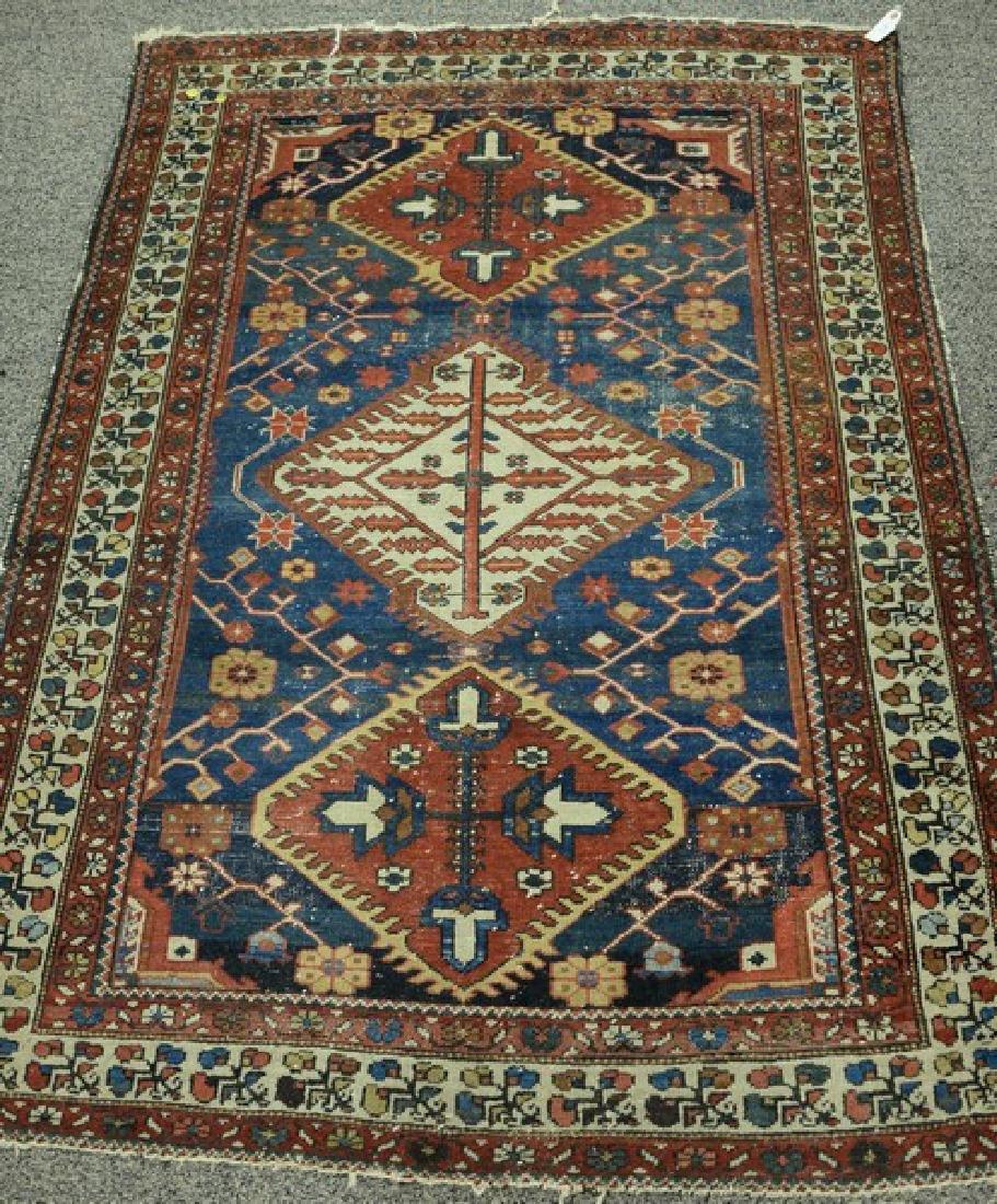 "Oriental throw rug (wear).  4'6"" x 6'3""  Provenance:"