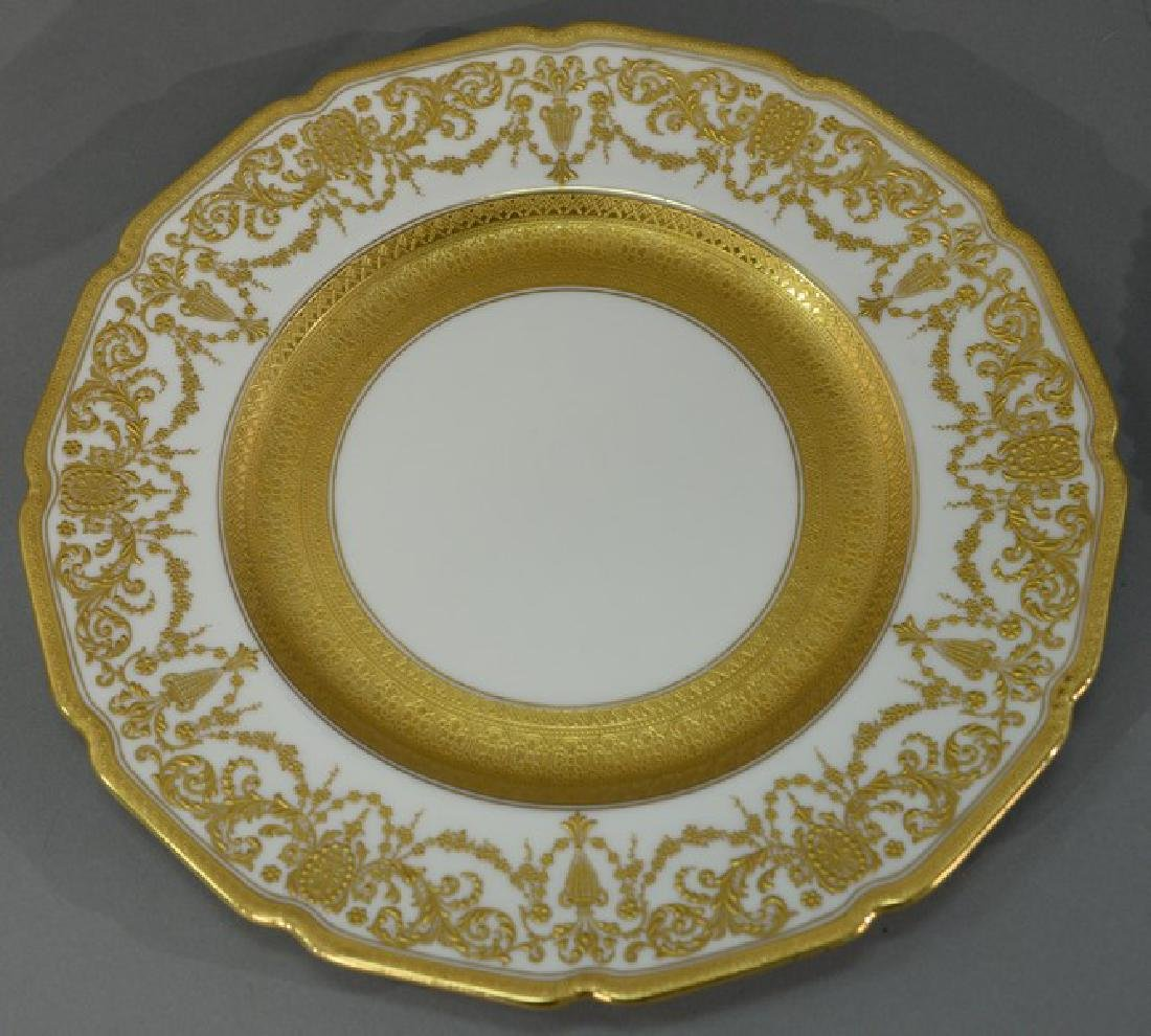 Set of twelve Royal Doulton service plates with raised