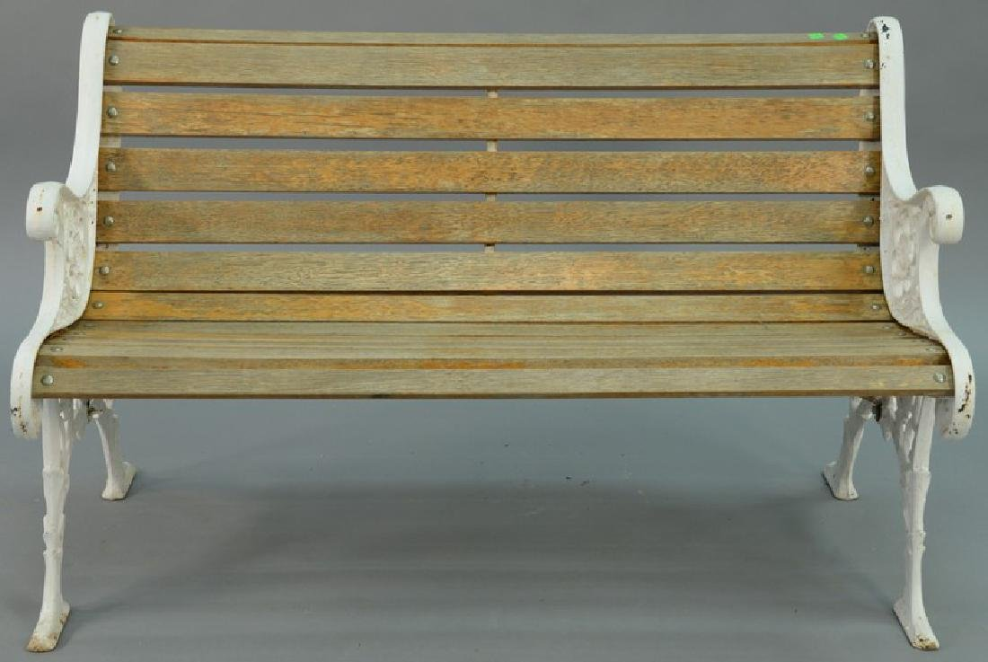 Park style bench having wood slats and iron ends.