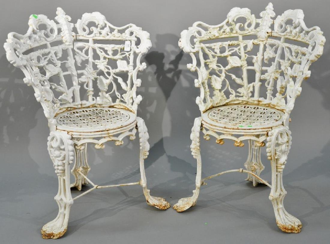 Pair of Victorian iron side chairs having floral and