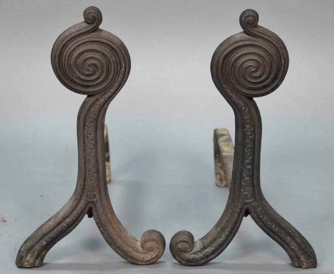 Pair of iron andirons with swirl circle tops, marked