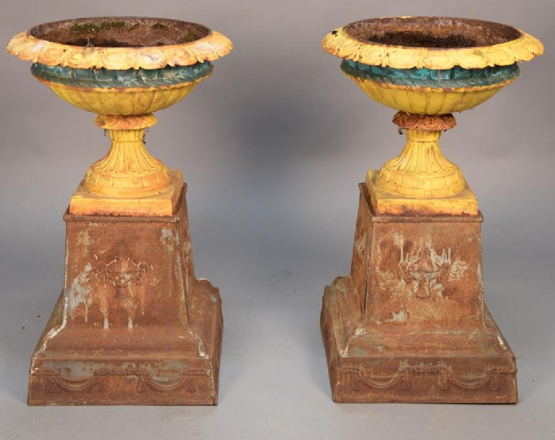 Pair of Victorian iron urns on stands.  height 36