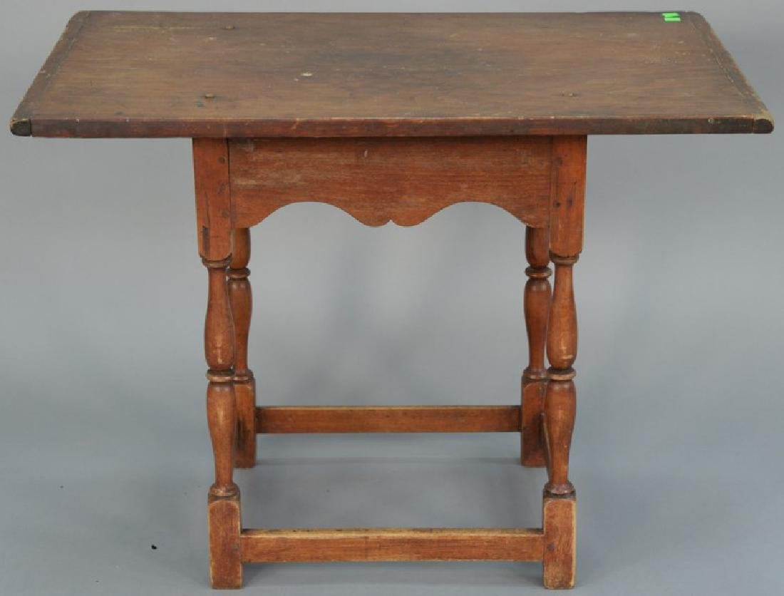 Primitive tavern table with scalloped skirt on turned