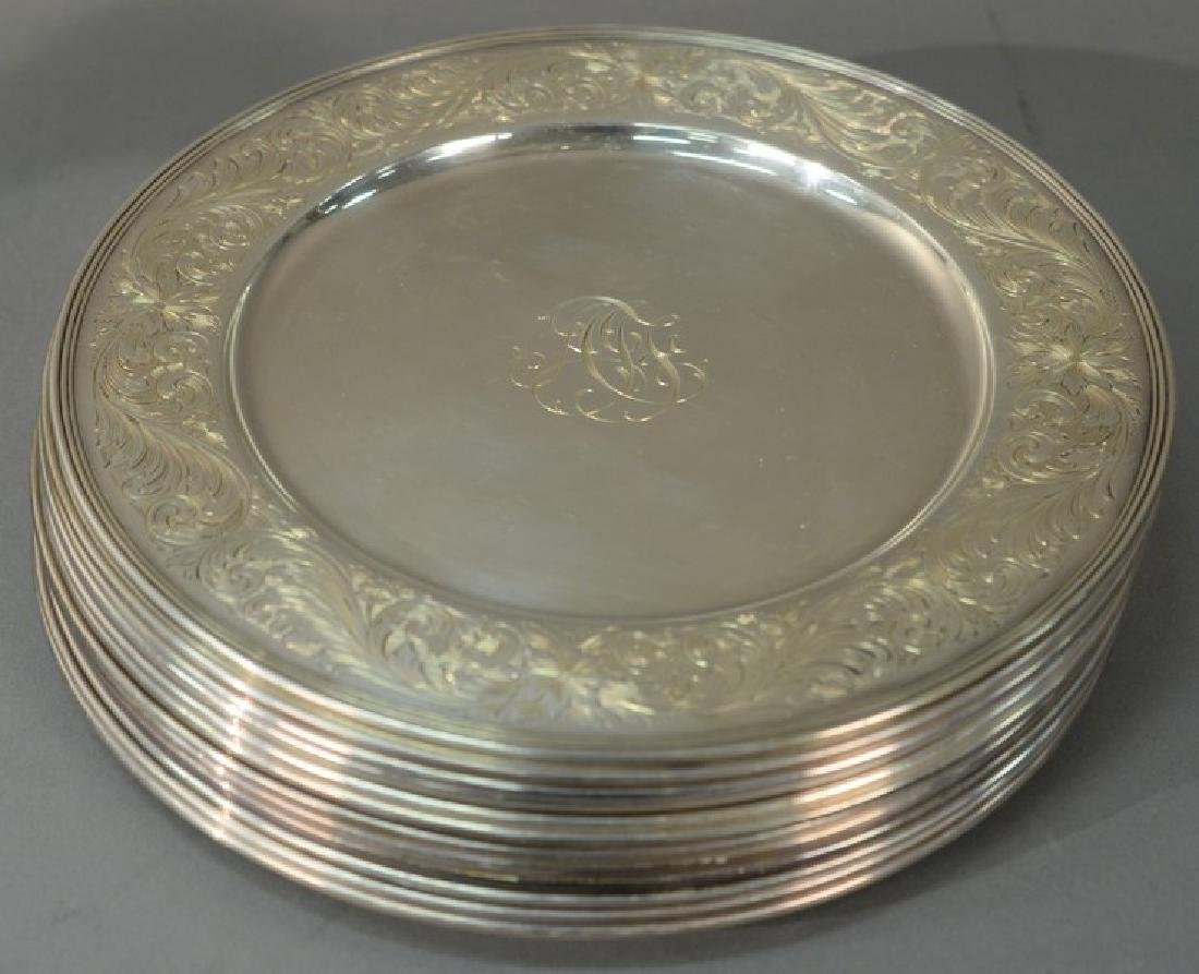 Set of twelve sterling silver service plates with