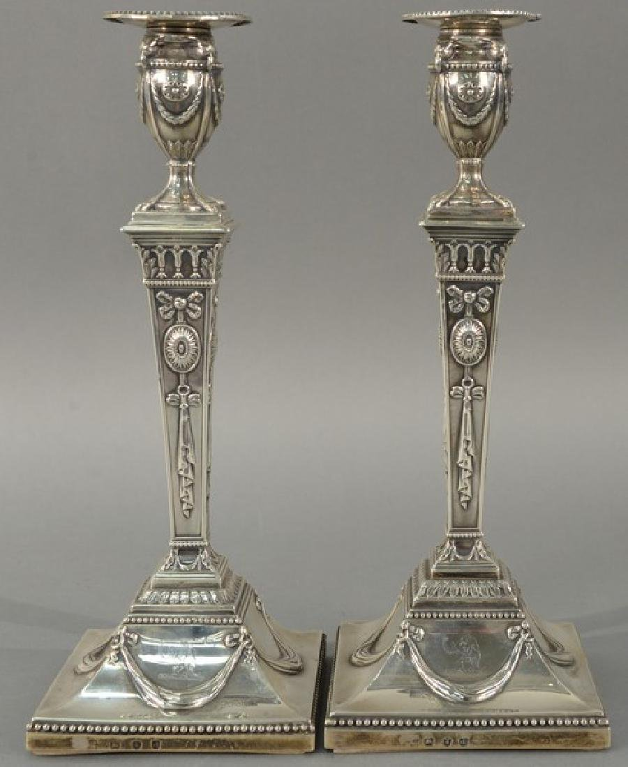 Pair of English silver candlesticks on square bases