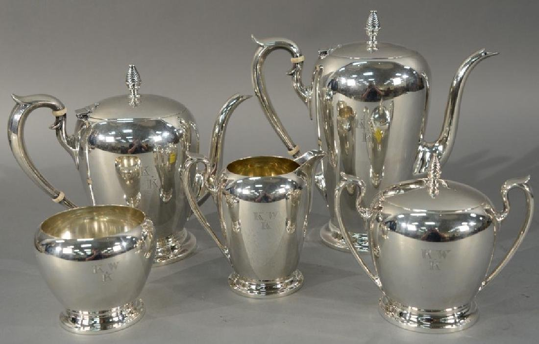 Five piece sterling silver tea and coffee set having