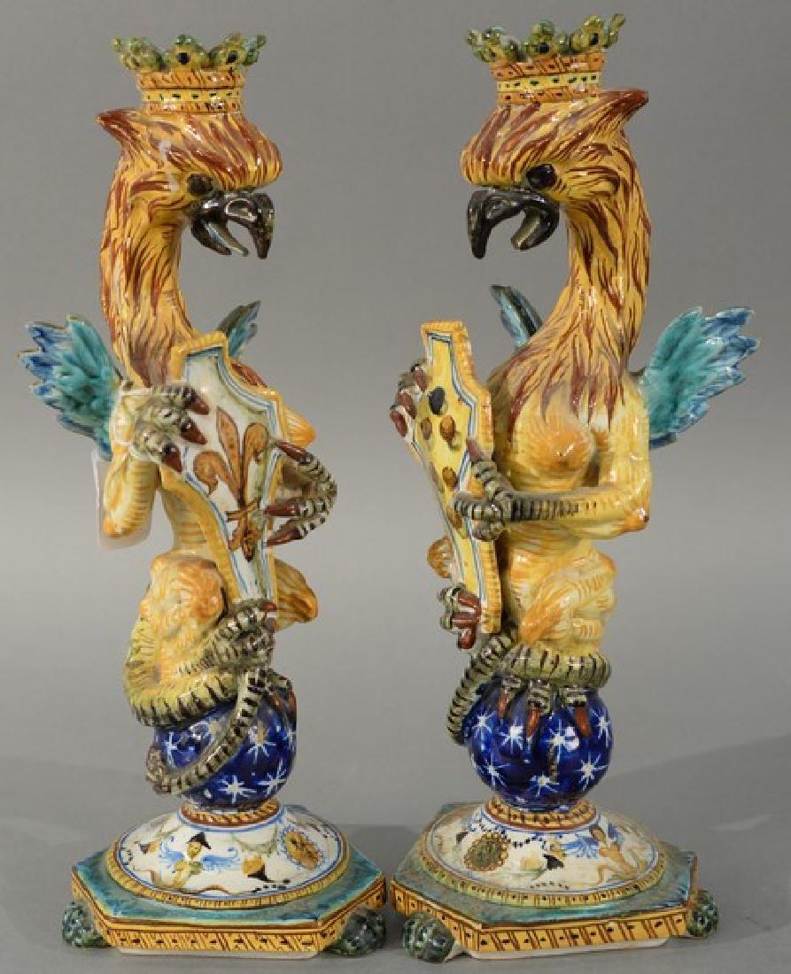 Pair of Majolica candlesticks having winged dragon on