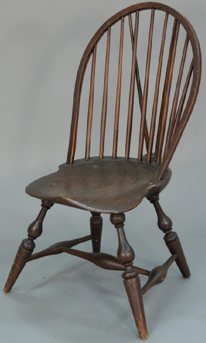 Windsor brace bow back side chair having saddle seat on