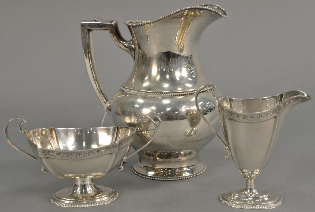 Three piece lot to include sterling silver pitcher (ht.