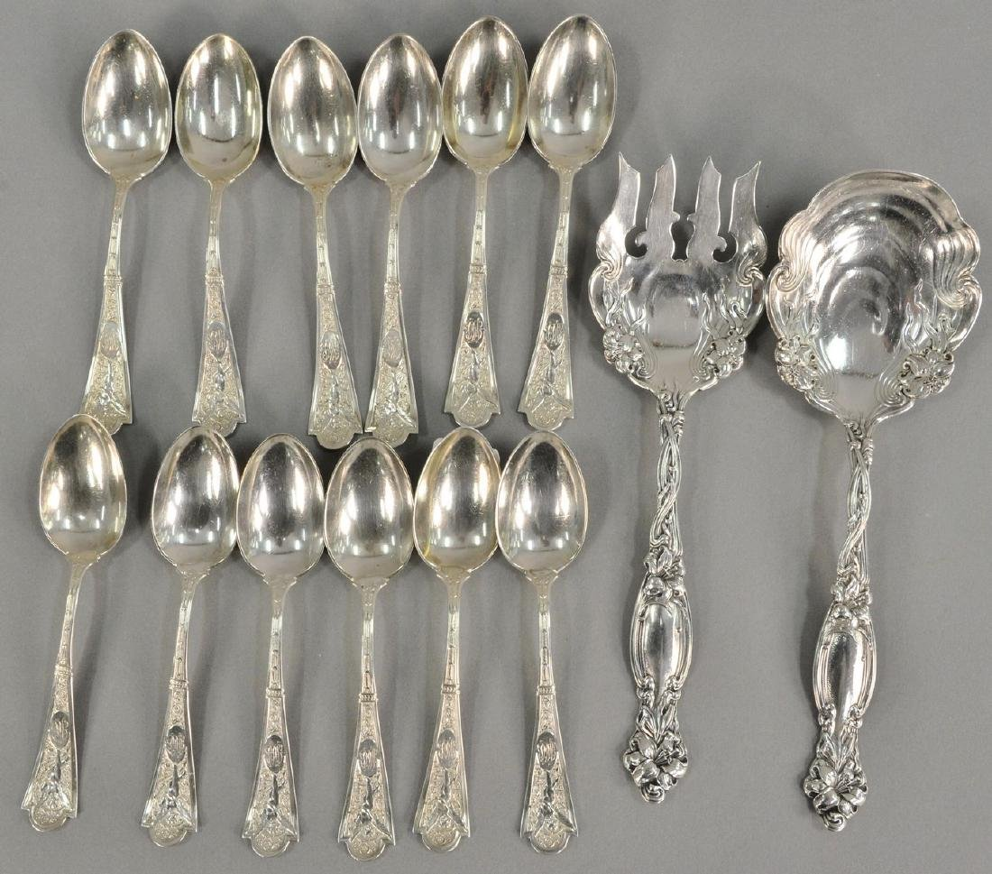 Fourteen piece sterling silver lot including two piece