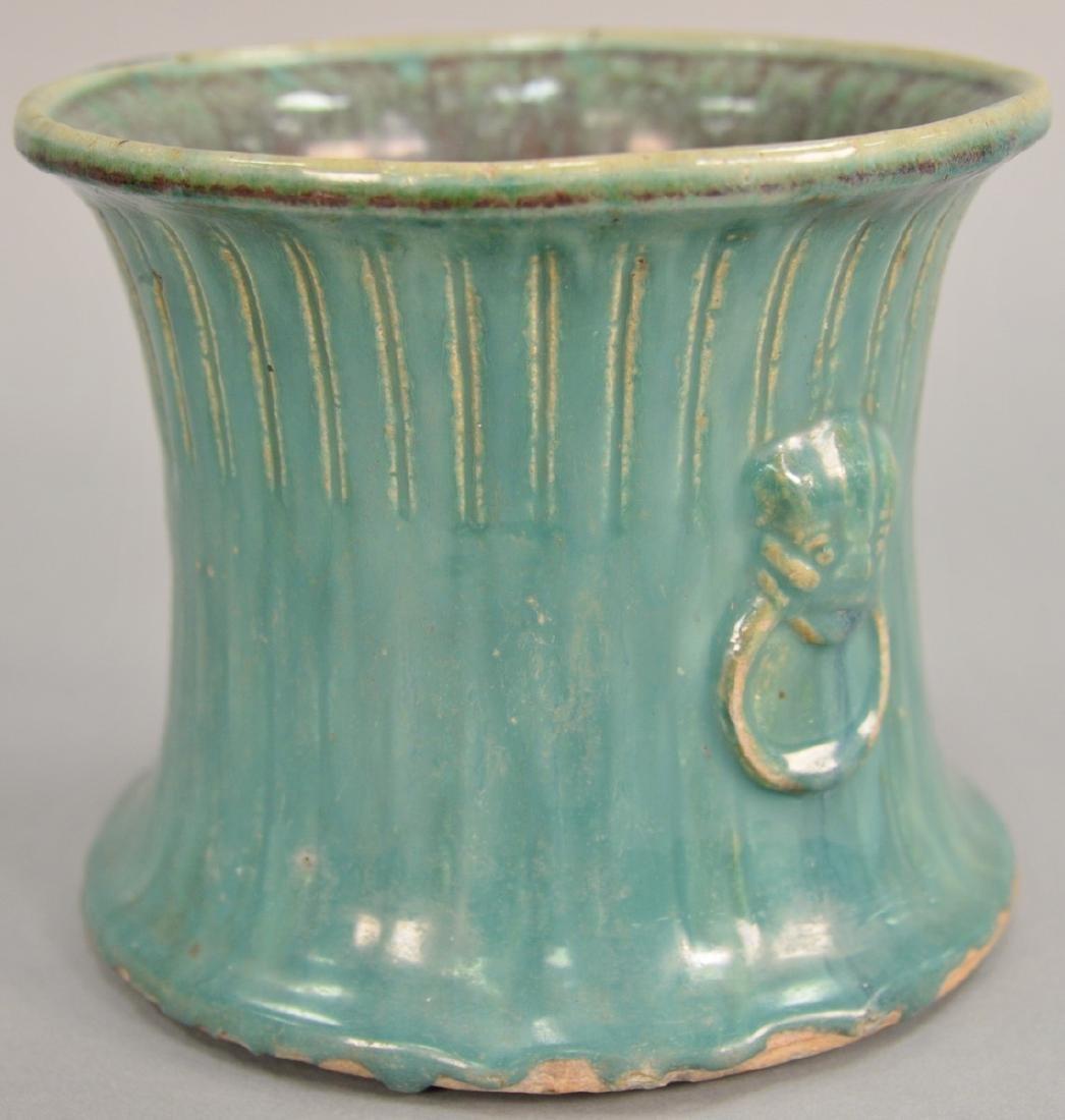 Chinese green glazed stoneware pot with molded foo dog