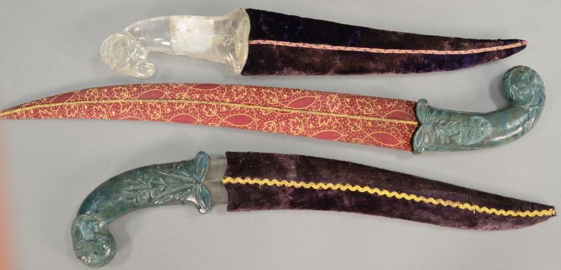 Three Asian daggers including two with carved jade