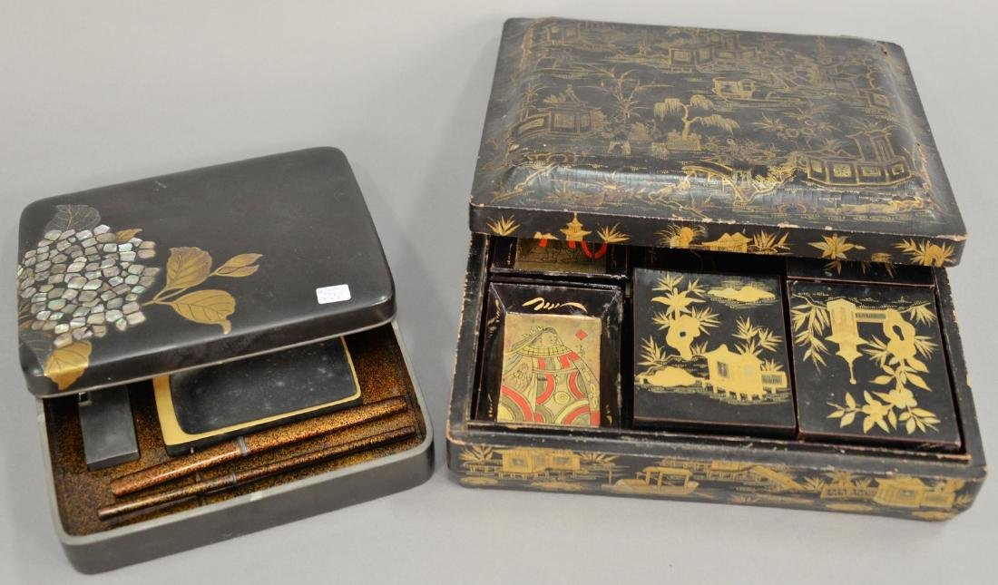 Two black lacquered boxes including writing or