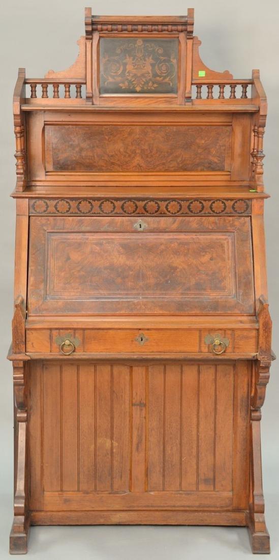 Victorian walnut and burl walnut desk with putti inlaid