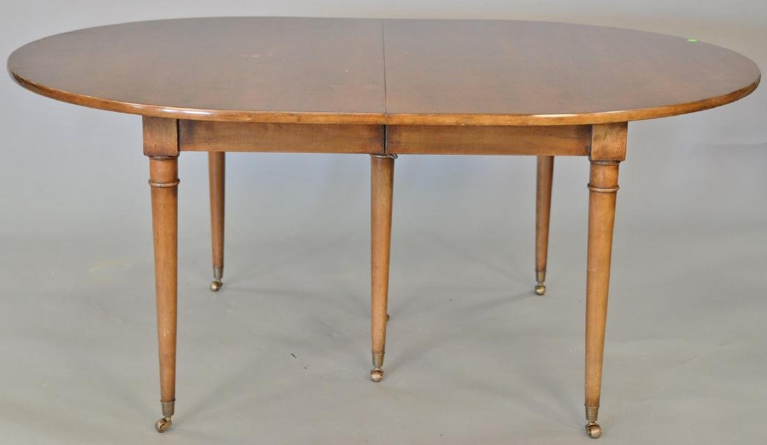 Louis XVI style fruitwood dining table with three 19