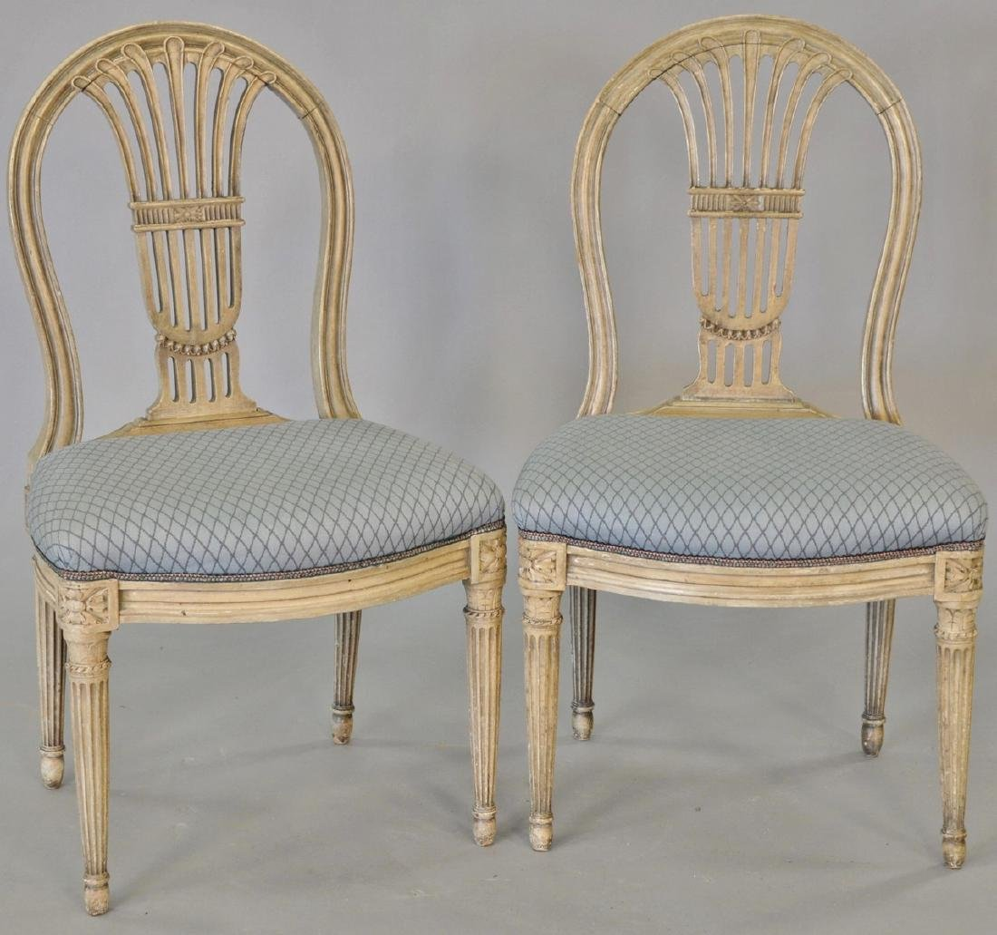 Set of nine Louis XVI style side chairs (painted).