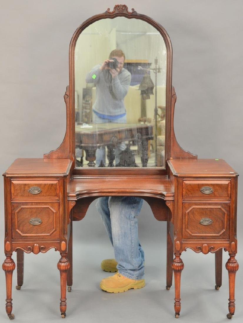 Two piece lot to include a mahogany vanity with mirror