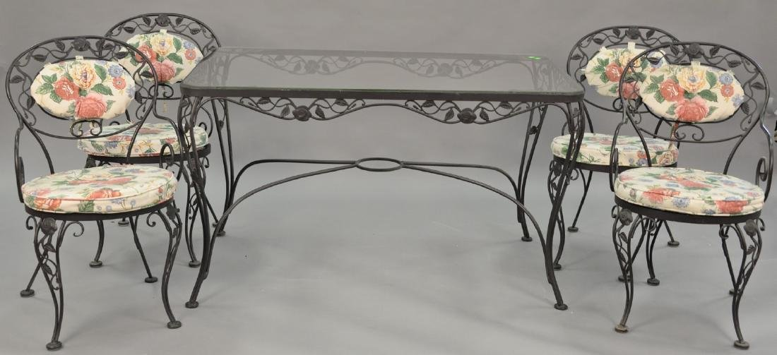 Five piece wrought iron glass top table and four chairs
