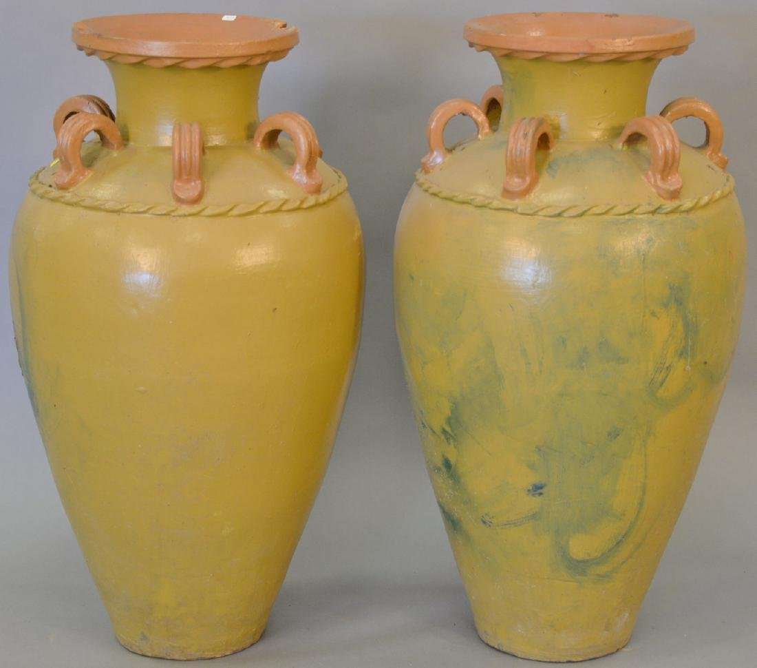 Pair of large earthenware urns (chips, two handles