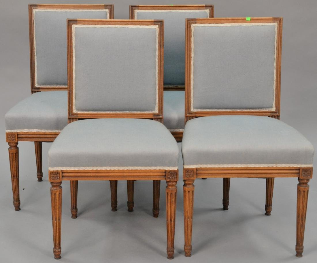 Set of four Louis XVI style side chairs.   Provenance: