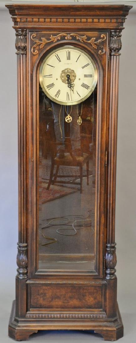 Howard Miller tall clock with three brass weights and