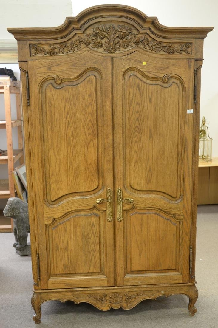 Louis XV style two door armoire with four fitted