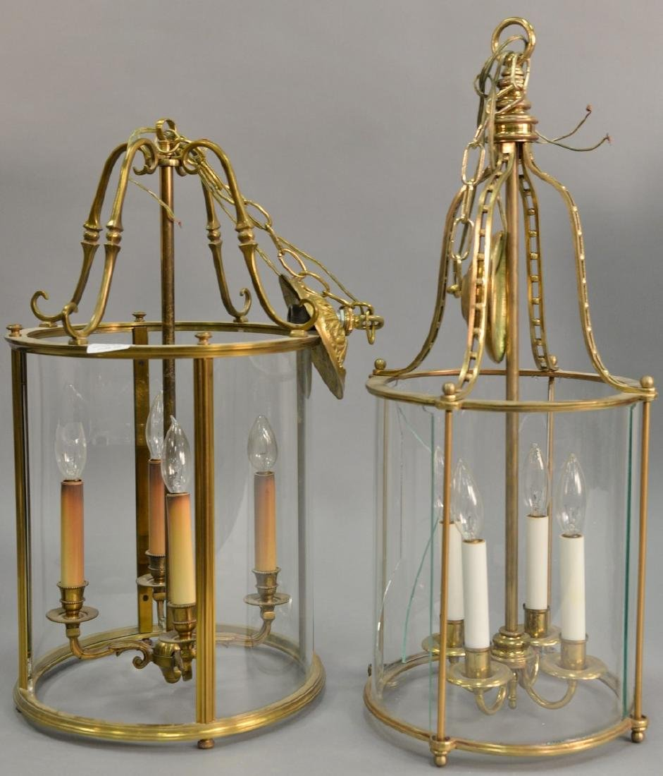 Two large brass and glass hanging lights, each with