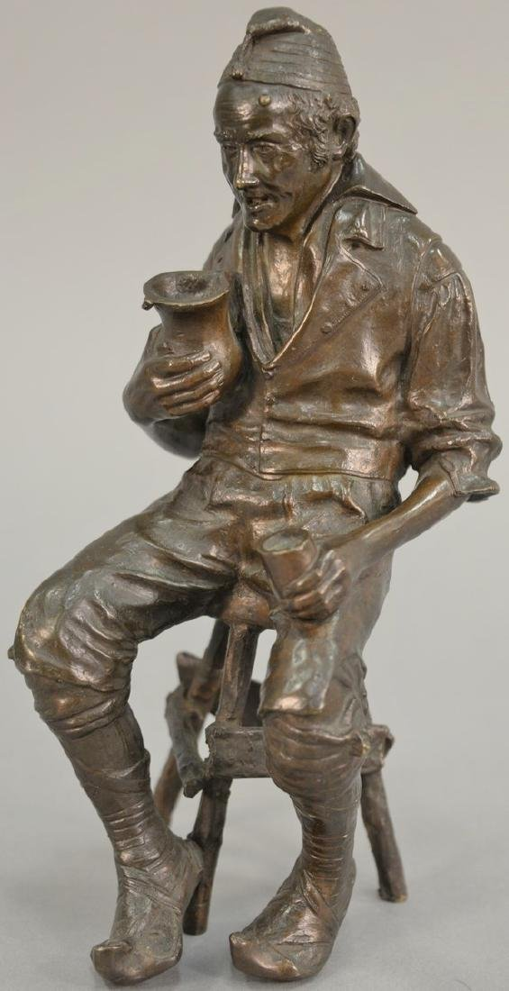 Bronze sculpture of an older man seated on a stool,