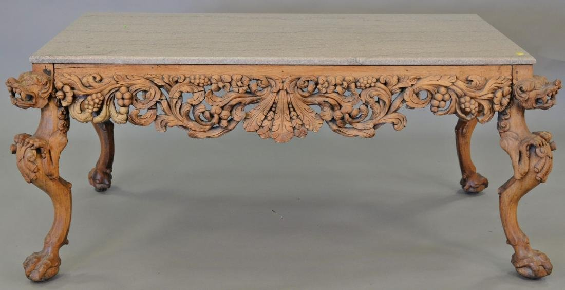Hardwood Chinese table having granite top over carved